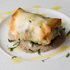 真鯛と帆立・ポルチーニの包み焼き 茸のデュクセルソースで